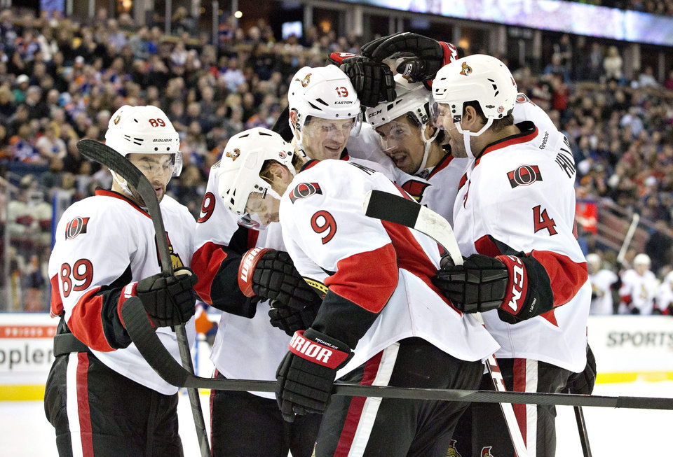 Photo - Ottawa Senators' Cory Conacher (89), Jason Spezza (19) Milan Michalel (9), Cody Ceci (5) and Chris Phillips (4) celebrate a goal against the Edmonton Oilers during the first period of an NHL hockey game, Tuesday, March 4, 2014 in Edmonton, Alberta. (AP Photo/The Canadian Press, Jason Franson)