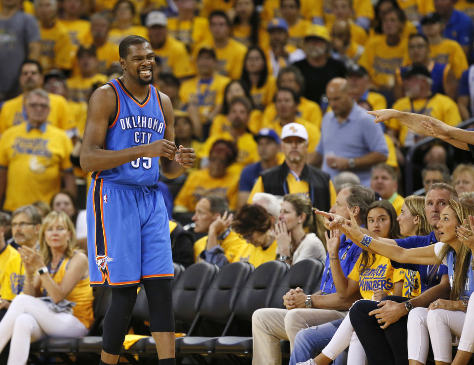 Photo - Oklahoma City's Kevin Durant (35) reacts after knocking the ball out of bounds while attempting a steal during Game 7 of the Western Conference finals in the NBA playoffs between the Oklahoma City Thunder and the Golden State Warriors at Oracle Arena in Oakland, Calif., Monday, May 30, 2016. Golden State won 96-88. Photo by Nate Billings, The Oklahoman