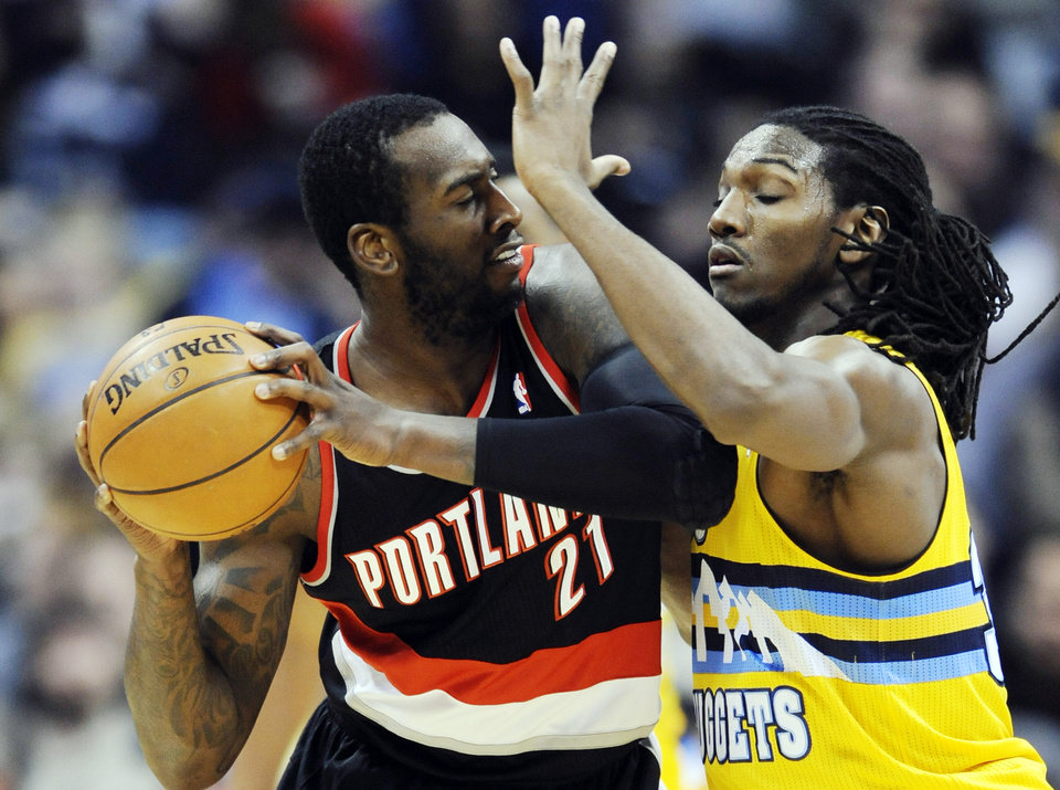 Photo - Denver Nuggets forward Kenneth Faried (35) pressures Portland Trail Blazers center J.J. Hickson (21) during the third quarter of an NBA basketball game, Tuesday, Jan. 15, 2013, in Denver. (AP Photo/Jack Dempsey)