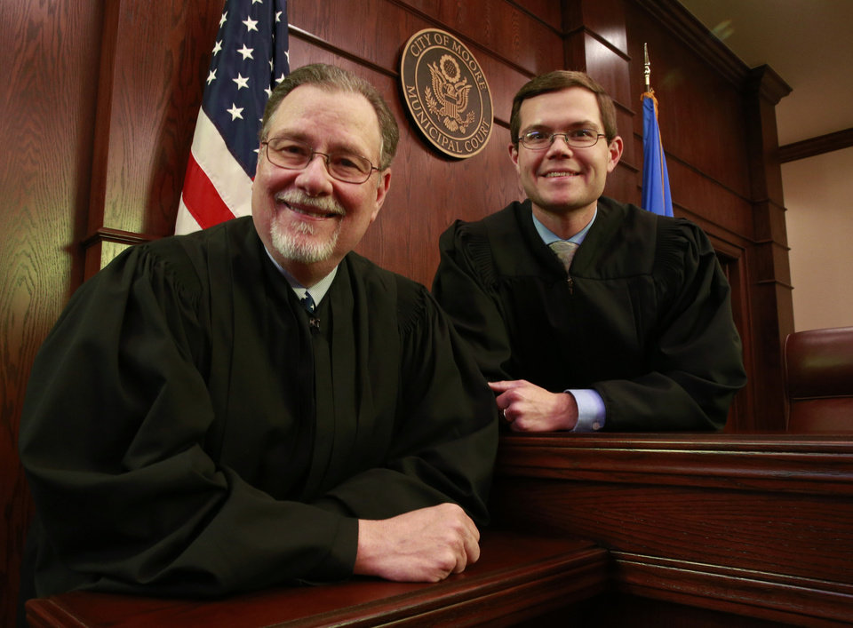 Photo - Long-time Municipal Court Judge Blake Virgin poses with his son, Jeff, who will soon be   a district judge.  Photo by Steve Sisney, The Oklahoman  STEVE SISNEY -