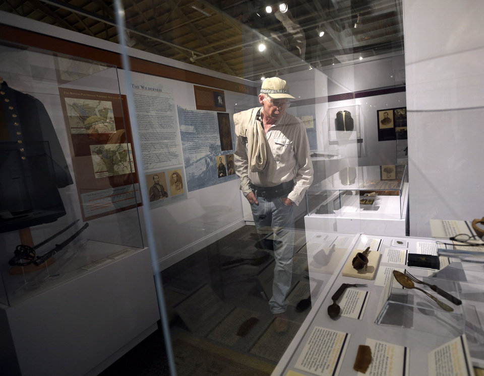 Photo - In this Wednesday, June 26, 2013 photo, David Anderson, of Seattle, visits a Civil War display highlighting artifacts from New York, at the New York State Military Museum, in Saratoga Springs, N.Y.  The exhibit, titled