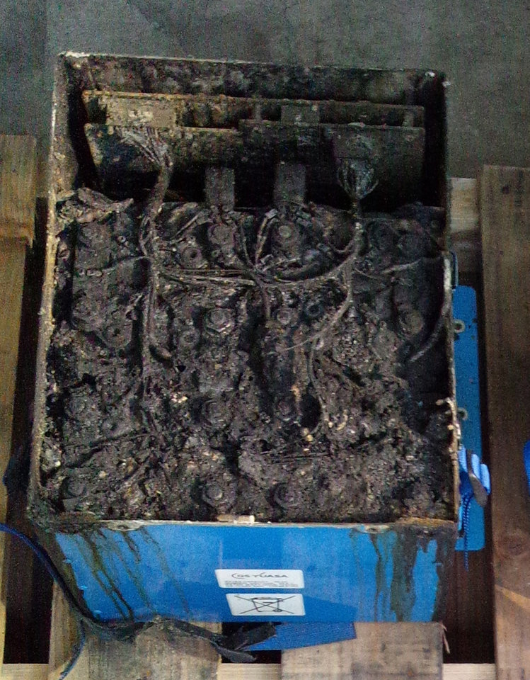 This Jan. 17, 2013 photo provided by the Japan Transport Safety Board shows the distorted main lithium-ion battery of the All Nippon Airways' Boeing 787 which made an emergency landing on Wednesday, Jan. 16, 2013 at Takamatsu airport in Takamatsu, western Japan. U.S. safety officials and Boeing inspectors joined a Japanese investigation Friday into the 787 jet at the center of a worldwide grounding of the technologically advanced aircraft. The pilot of the ANA plane made an emergency landing Wednesday morning after he smelled something burning and received a cockpit warning of battery problems. All passengers evacuated the plane on emergency slides. (AP Photo/Japan Transport Safety Board) EDITORIAL USE ONLY, NO SALES