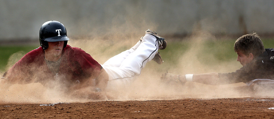 Photo - Tuttle's Conner Fryrear slides safely into home as Catoosa's Ronnie Anello tries to tag him during the class 3A baseball game at Edmond Memorial High School in Edmond, Okla., Friday, May 16, 2014. Photo by Sarah Phipps, The Oklahoman