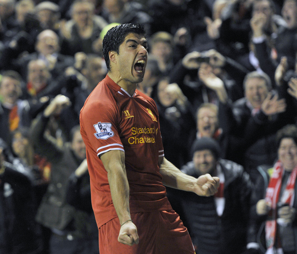 Photo - Liverpool's Luis Suarez celebrates after he scores the fourth goal of the game for his side during their English Premier League soccer match against Everton at Anfield in Liverpool, England, Tuesday Jan. 28, 2014. (AP Photo/Clint Hughes)