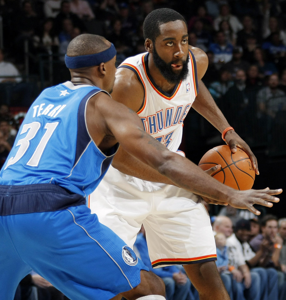 Oklahoma City's James Harden (13) looks to pass the ball around Jason Terry (31) of Dallas during the NBA basketball game between the Dallas Mavericks and the Oklahoma City Thunder at the Oklahoma City Arena in Oklahoma City, Monday, Dec. 27, 2010. Photo by Nate Billings, The Oklahoman