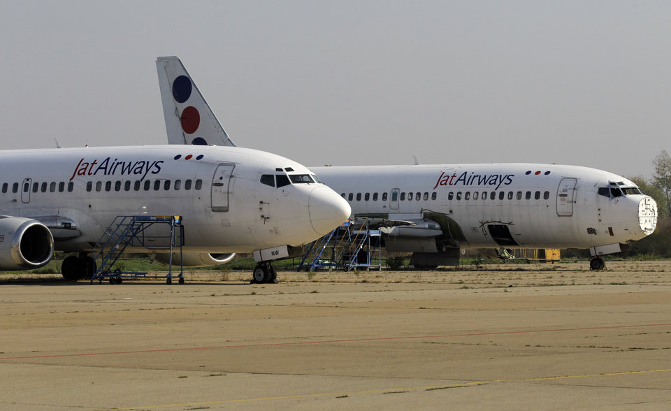 Photo - Two old JAT Airways planes are parked on the tarmac at Belgrade's Nikola Tesla Airport, Serbia, Friday, Oct. 25, 2013. Air Serbia, the Balkan country's new national carrier partly owned by Etihad Airways, formally starts flying this weekend, spelling the end for the old loss-making JAT Airways. (AP Photo/Darko Vojinovic)