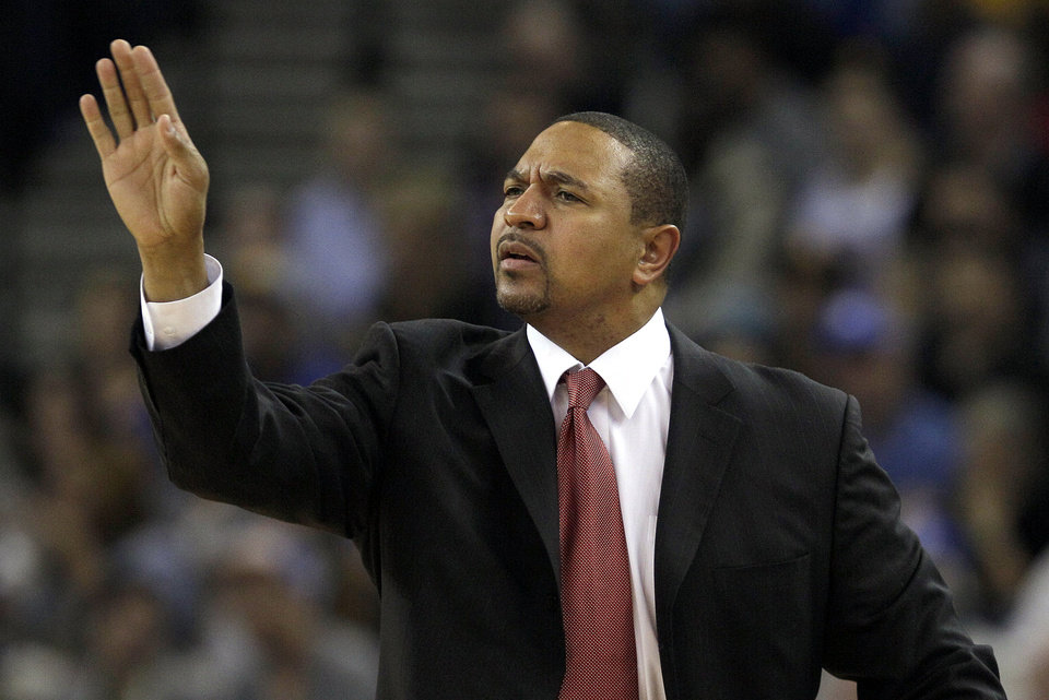 Golden State Warriors head coach Mark Jackson signals to his team during the second quarter of an NBA basketball game against the Cleveland Cavaliers in Oakland, Calif., Wednesday, Nov. 7, 2012. (AP Photo/Jeff Chiu)
