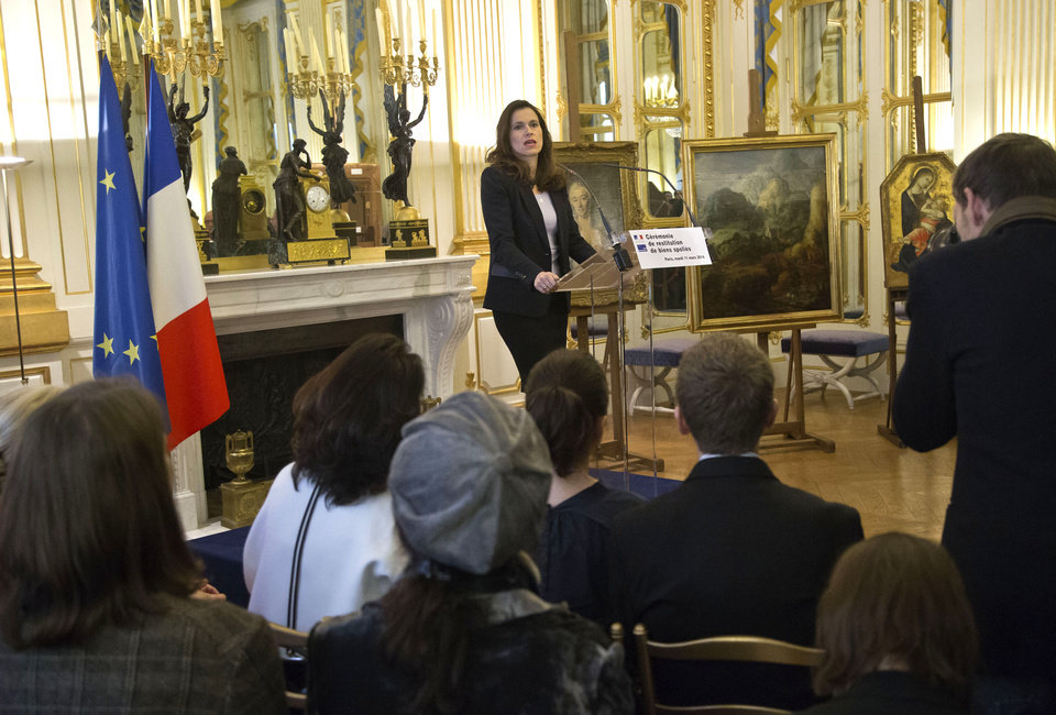 Photo - France's culture minister Aurelie Filipetti, speaks during a ceremony to return three paintings taken from their owners during World War II at the Culture Ministry in Paris, Tuesday, March 11, 2014. The restitution is part of France's ongoing effort to return hundreds of looted artworks that Jewish owners lost during the war that still hang in the Louvre and other museums. (AP Photo/Michel Euler)