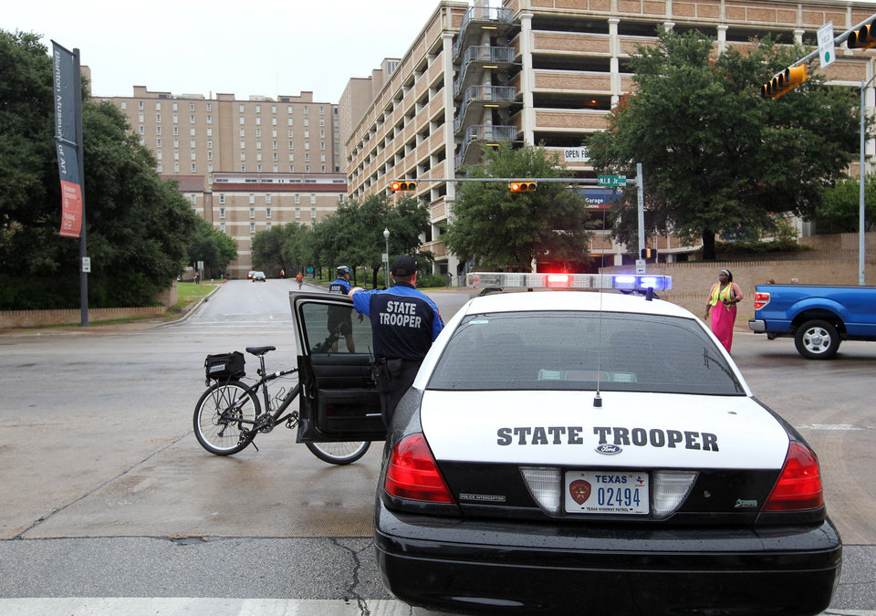 Photo -   State troopers secure the University of Texas campus after students evacuated because of a bomb threat Friday morning, Sept. 14, 2012 in Austin, Texas. The university received a call about 8:35 a.m. local time from a man claiming to be with al-Qaida who said he had placed bombs all over the 50,000-student Austin campus, according to University of Texas spokeswoman Rhonda Weldon. (AP Photo/Statesman.com, Ralph Barrera)