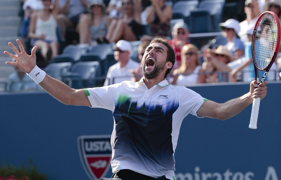 Photo - Marin Cilic, of Croatia, reacts after defeating Tomas Berdych, of the Czech Republic, during the quarterfinals of the 2014 U.S. Open tennis tournament, Thursday, Sept. 4, 2014, in New York. (AP Photo/Julio Cortez)