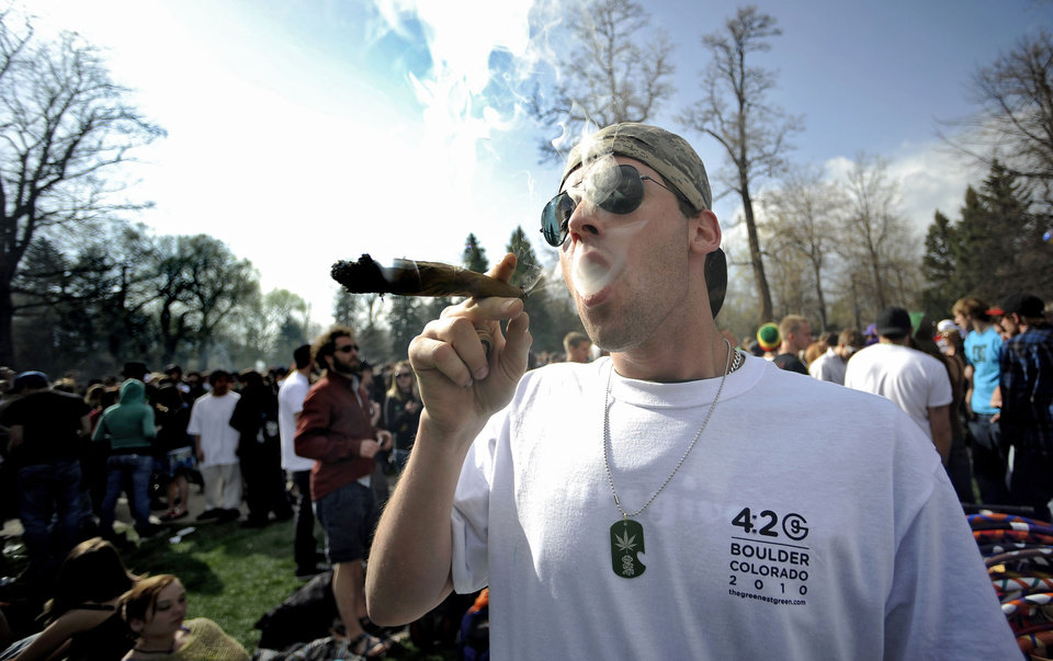 Photo -   FILE - In this April 20, 2009 file photo Garrett Kramer smokes marijuana during the 420 event on Norlin Quad at the University of Colorado in Boulder, Colo. The University of Colorado is closing its campus to outsiders on Friday and closing the Norlin Quad to prevent a 420 gathering. For years, the term