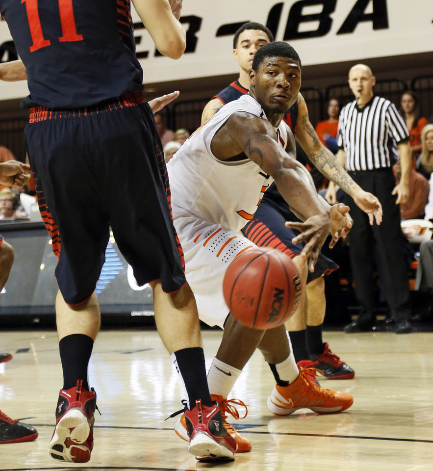Oklahoma State\'s Marcus Smart (33) passes the ball around Texas Tech\'s Dejan Kravic (11) during a men\'s college basketball game between Oklahoma State University and Texas Tech at Gallagher-Iba Arena in Stillwater, Okla., Saturday, Jan. 19, 2013. OSU won, 79-45. Photo by Nate Billings, The Oklahoman