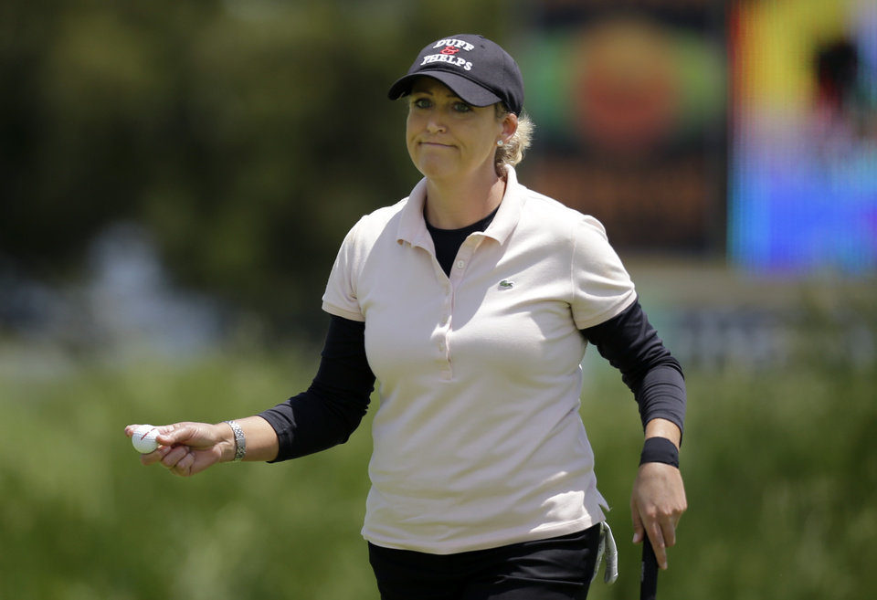Photo - Cristie Kerr holds her ball after putting on the ninth hole during the first round of the ShopRite LPGA Classic golf tournament in Galloway Township, N.J., Friday, May 30, 2014.  (AP Photo/Mel Evans)