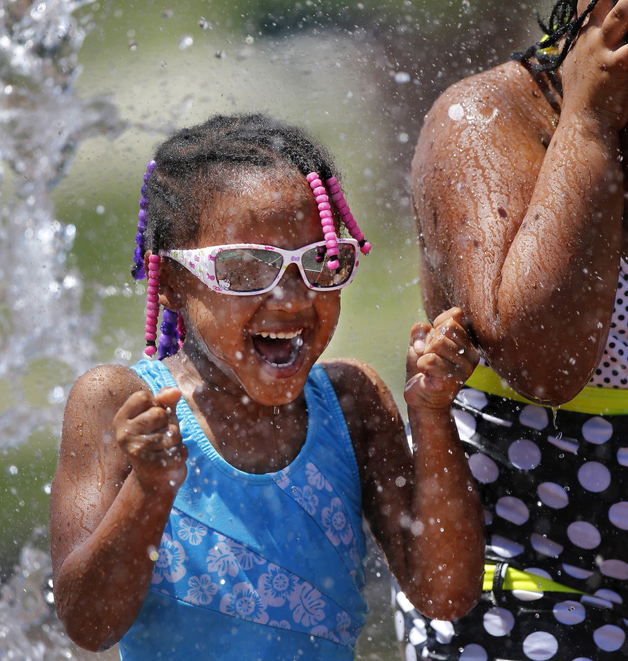 With temperatures and heat indexes hovering near 100 degrees, some looked for ways to beat the oppressive heat. These children enjoyed refreshing water while playing at a city spray park in Memorial Park at NW 36 and Classen on Monday afternoon, Monday, July 22, 2013. Photo  by Jim Beckel, The Oklahoman.