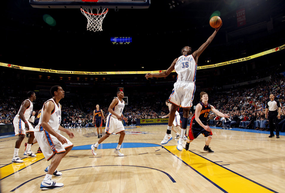 Photo - Oklahoma City's Kevin Durant (35) grabs a rebound during the NBA game between the Oklahoma City Thunder and Golden State Warriors, Sunday, Jan. 31, 2010, at the Ford Center in Oklahoma City. Photo by Sarah Phipps, The Oklahoman