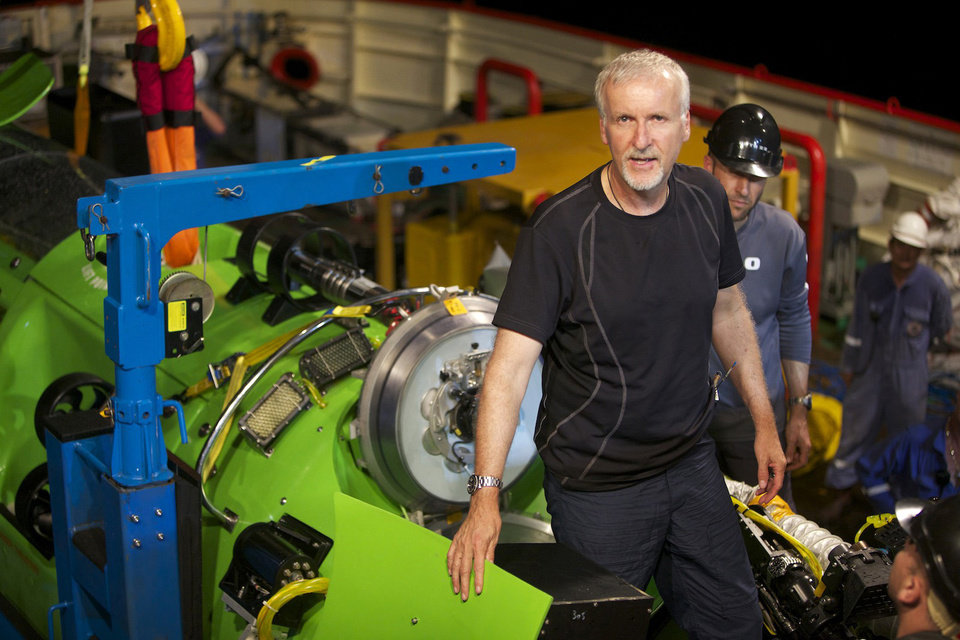 This February 2012 photo, provided by National Geographic, shows explorer and filmmaker James Cameron emerging from the hatch of DEEPSEA CHALLENGER during testing of the submersible in Jervis Bay, south of Sydney, Australia. Earth's lost frontier, the deepest part of the oceans where the pressure is like three SUVs sitting on your little toe, is about to be explored first-hand. It's been more than half a century since man dared to plunge that deep. (AP Photo/Mark Thiessen, National Geographic)