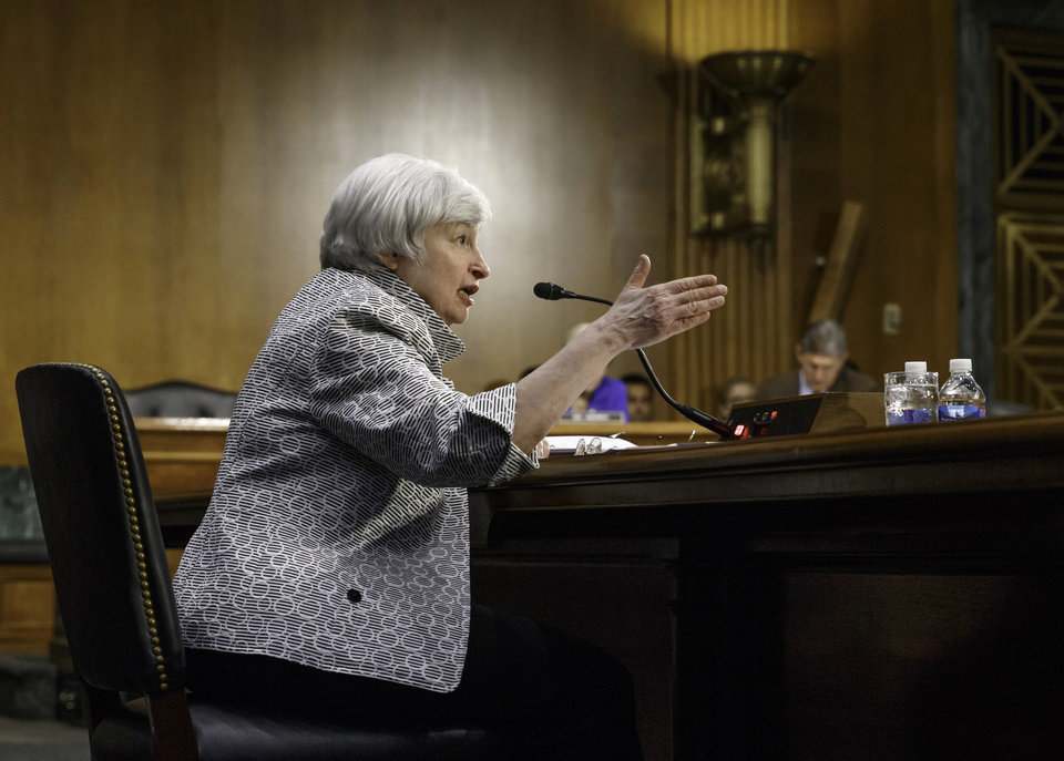 Photo - Federal Reserve Chair Janet Yellen testifies on Capitol Hill in Washington, Tuesday, July 15, 2014, before  the Senate Banking Committee. Yellen said Tuesday that the economic recovery is not yet complete and for that reason the Fed intends to keep providing significant support to boost growth and improve labor market conditions.  (AP Photo/J. Scott Applewhite)