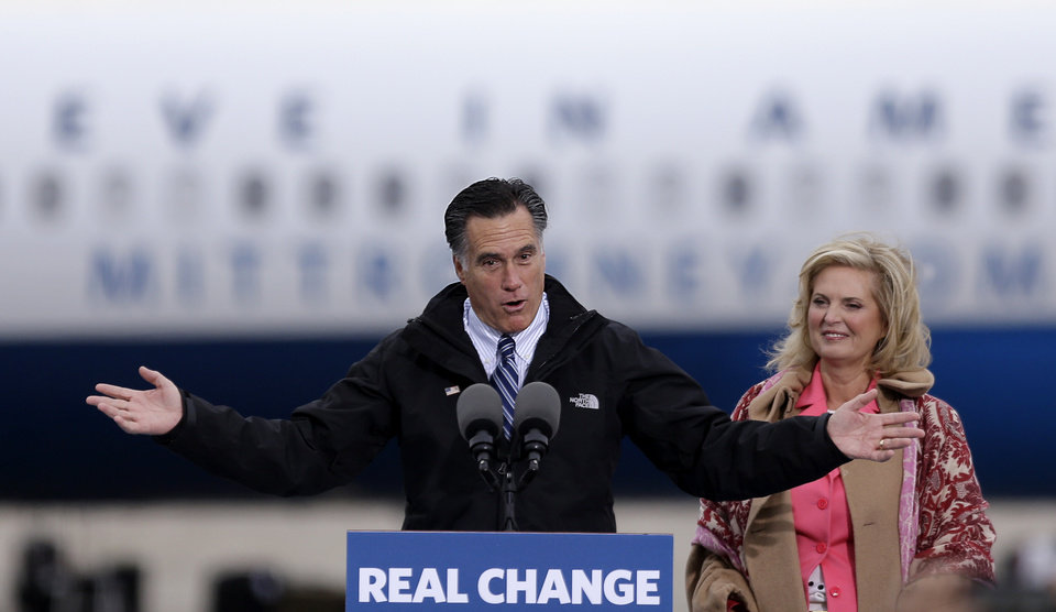 Republican presidential candidate, former Massachusetts Gov. Mitt Romney, left, speaks during a campaign event at Portsmouth International Airport as his wife Ann looks on, Saturday, Nov. 3, 2012, in Newington, N.H. (AP Photo/David Goldman)