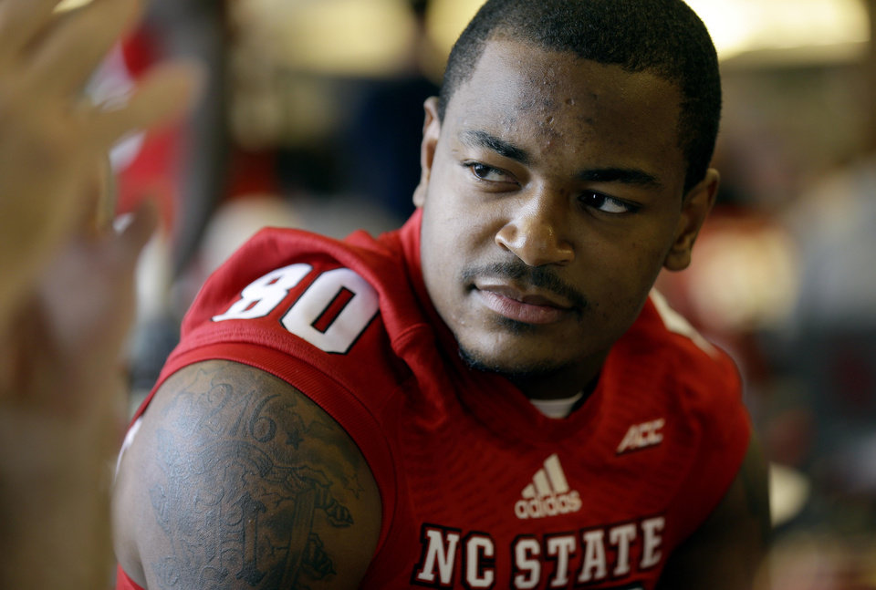 Photo - North Carolina State wide receiver Bryan Underwood speaks with reporters during an NCAA football media day in Raleigh, N.C., Sunday, Aug. 10, 2014. (AP Photo/Gerry Broome)