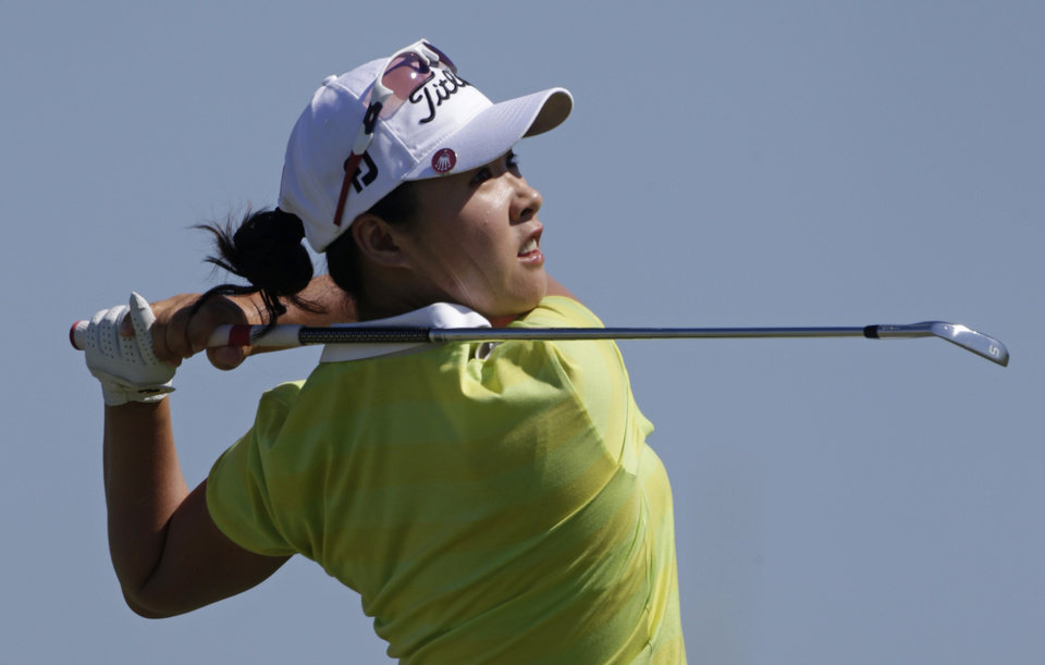 Photo -   Haeji Kang, of South Korea, watches her tee shot on the second hole during final round play in the Navistar LPGA Classic golf tournament on Sunday, Sept. 23, 2012, at the Robert Trent Jones Golf Trail in Prattville, Ala. (AP Photo/Dave Martin)