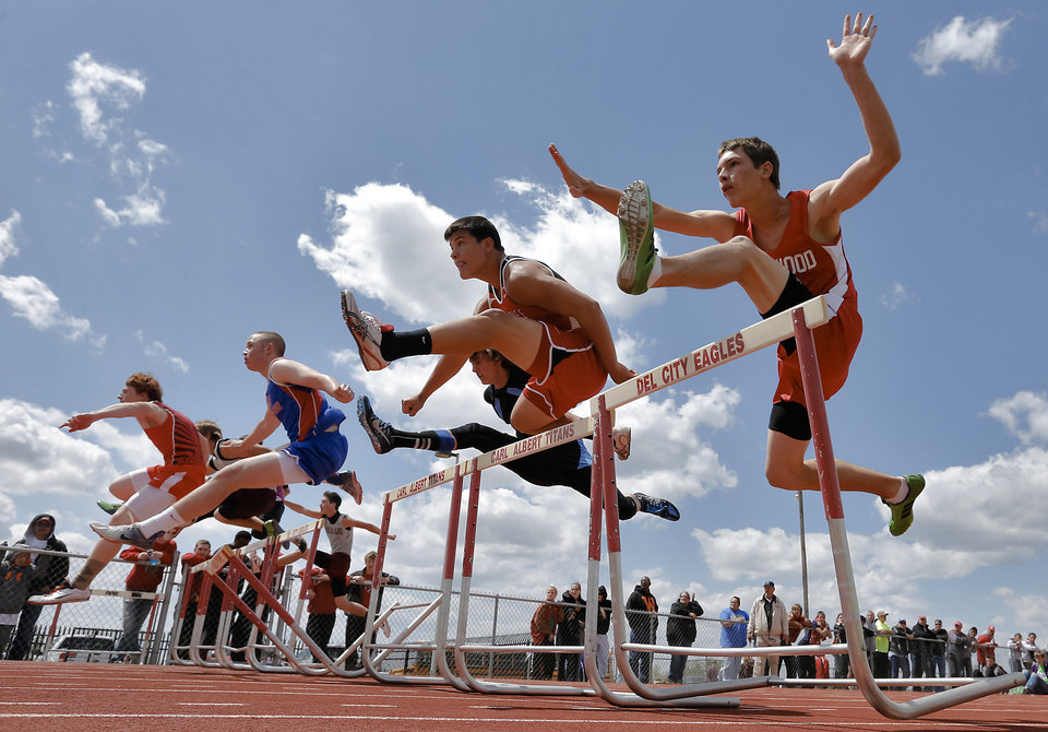 The Class A boys race in the 110m hurdles during the Class A and 2A state championship track meet at Carl Albert High School on Friday, May 3, 2013, in Midwest City, Okla. Photo by Chris Landsberger, The Oklahoman