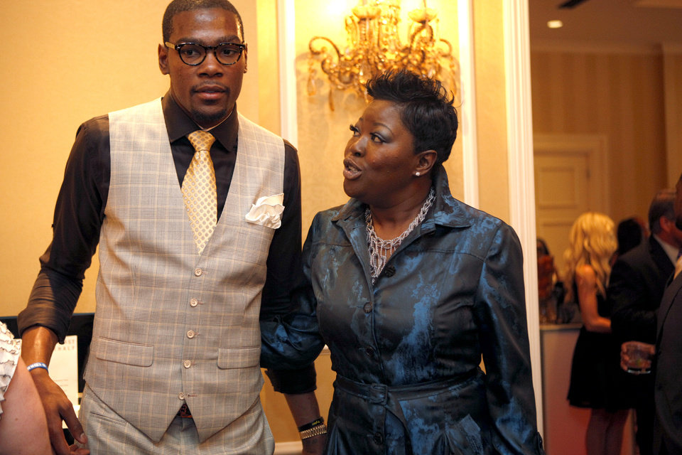 Photo - Oklahoma City Thunder's Kevin Durant talks with his mother, Wanda Pratt, during the KD 35 Ball benefiting the Kevin Durant Family Foundation at the Skirvin Hilton Hotel in Oklahoma City, Saturday, March 31, 2012. Photo by Sarah Phipps The Oklahoman