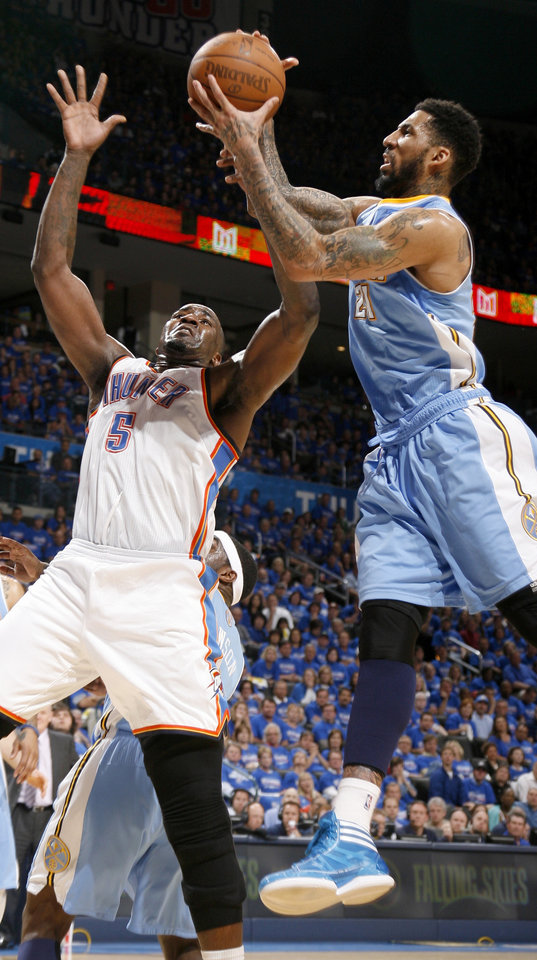 Photo - Oklahoma City's Kendrick Perkins (5) goes for the basket beside Denver's Wilson Chandler (21) during the NBA basketball game between the Denver Nuggets and the Oklahoma City Thunder in the first round of the NBA playoffs at the Oklahoma City Arena, Sunday, April 17, 2011. Photo by Bryan Terry, The Oklahoman
