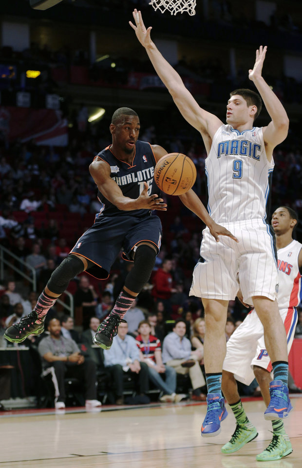 Team Shaq's Kemba Walker of the Charlotte Bobcats passes the ball around Team Chuck's Nikola Vucevic of the Orlando Magic, from Montenegro, during the first half of the Rising Stars Challenge basketball game at NBA All-Star Weekend Friday, Feb. 15, 2013, in Houston. (AP Photo/Eric Gay)