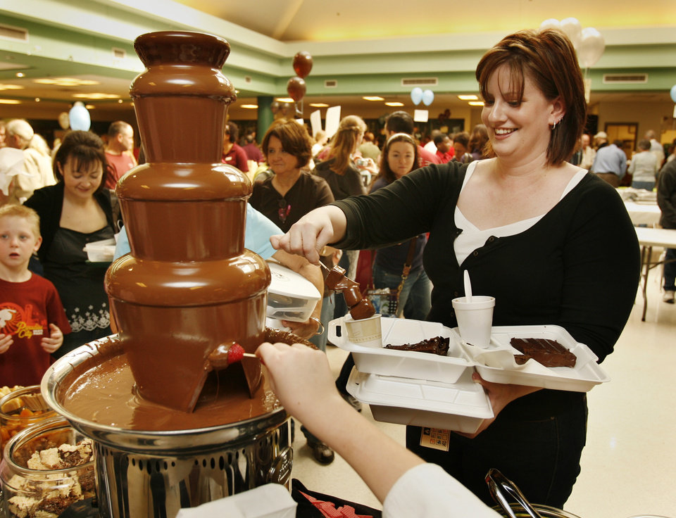 Photo - Courtney Wenger of Drum, Texas, partakes of a chocolate fountain at the 27th Annual Chocolate Festival benefiting the Firehouse Art Station in Norman, Okla. on Saturday, Feb. 7, 2009.   Photo by Steve Sisney, The Oklahoman