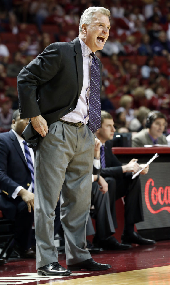 Kansas State head coach Bruce Weber talks with his team in the first half as the University of Oklahoma Sooner (OU) men play the Kansas State Wildcats (KS) in NCAA, college basketball at The Lloyd Noble Center on Saturday, Feb. 22, 2014 in Norman, Okla. Photo by Steve Sisney, The Oklahoman