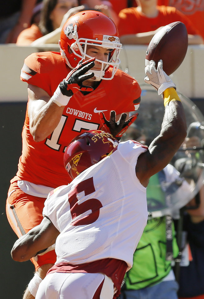 Photo - Iowa State's Jeremy Reeves (5) knocks away a pass intended for Oklahoma State's Charlie Moore (17) in the end zone during the second quarter of a college football game between Oklahoma State University (OSU) and Iowa State University (ISU) at Boone Pickens Stadium in Stillwater, Okla., Saturday, Oct. 20, 2012. Photo by Nate Billings, The Oklahoman