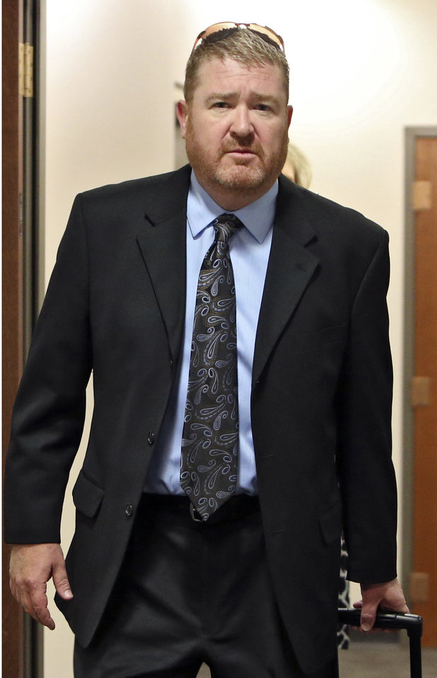 Photo - Defense attorney Daniel King arrives at court for a hearing where his client, Aurora theater shooting suspect James Holmes, asked a judge to enter a plea of not guilty by reason of insanity, in Centennial, Colo., on Monday,  May 13, 2013. (AP Photo/Ed Andrieski)