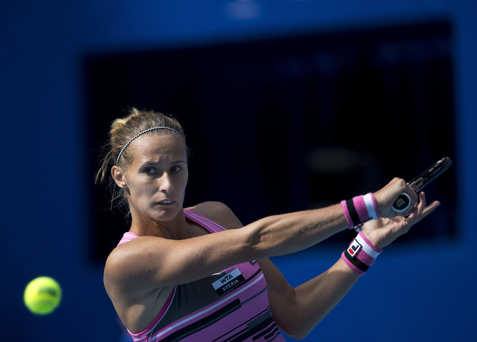 Photo -   Polona Hercog of Slovenia prepares to return a shot to Maria Sharapova of Russia during their women's singles match of the China Open tennis tournament in Beijing Thursday, Oct. 4, 2012. Sharapova defeated Hercog 6-0, 6-2. (AP Photo/Andy Wong)