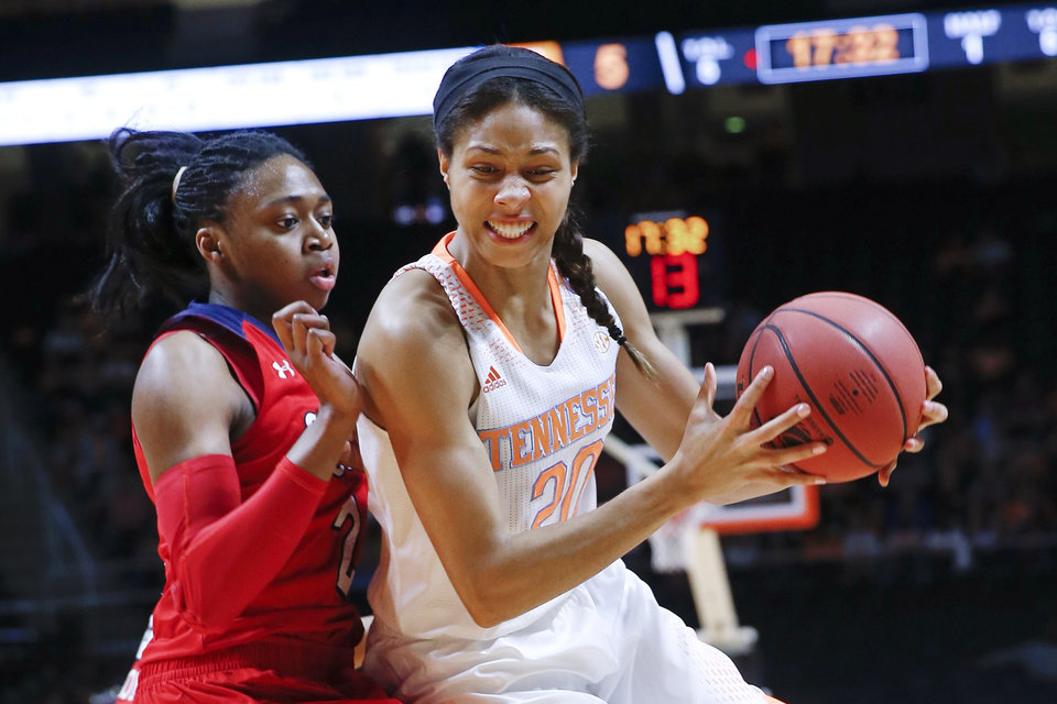 Photo - Tennessee center Isabelle Harrison (20) drives against St. John's forward Amber Thompson, left, in the first half of an NCAA women's college basketball second-round tournament game Monday, March 24, 2014, in Knoxville, Tenn. (AP Photo/John Bazemore)