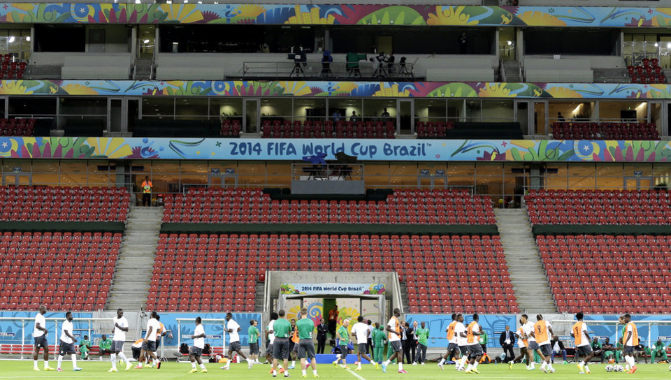 Photo - Ivory Coast's players warm up during a training session of Ivory Coast at the Arena Pernambuco  in Recife, Brazil, Friday, June 13, 2014.  Ivory Coast play in group C of the 2014 soccer World Cup. (AP Photo/Shuji Kajiyama)