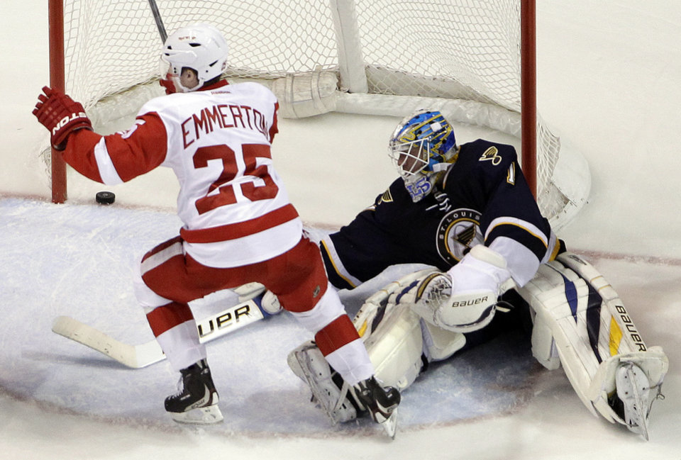 Detroit Red Wings' Cory Emmerton, left, celebrates after scoring past St. Louis Blues goalie Brian Elliott during the second period of an NHL hockey game Thursday, Feb. 7, 2013, in St. Louis. (AP Photo/Jeff Roberson)