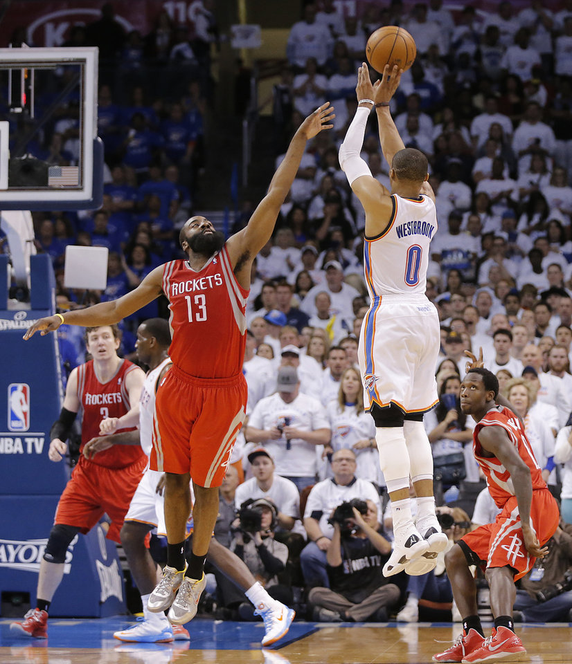 Houston's James Harden (13) and Patrick Beverley (12) defend on Oklahoma City's Russell Westbrook (0) during Game 2 in the first round of the NBA playoffs between the Oklahoma City Thunder and the Houston Rockets at Chesapeake Energy Arena in Oklahoma City, Wednesday, April 24, 2013. Photo by Chris Landsberger, The Oklahoman