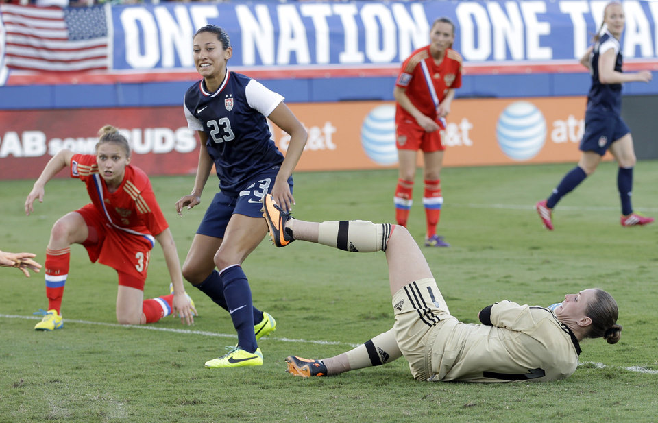 Photo - United State's Christen Press (23) smiles after scoring against Russia during an international friendly soccer match in Boca Raton, Fla., Saturday, Feb. 8, 2014. The U.S. won 7-0. (AP Photo/Alan Diaz)