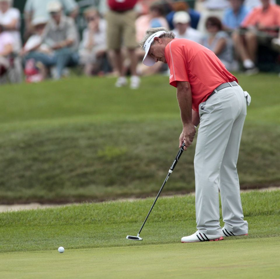 Photo - John Cook misses his eagle putt on the 18th hole during the second round of the Champions Tour's 3M Championship golf tournament at TPC Twin Cities in Blaine, Minn., Saturday, Aug. 2, 2014. (AP Photo/Paul Battaglia)