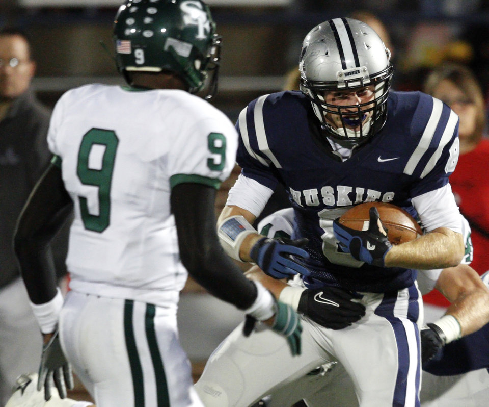 Edmond North's Garrett Molinsky looks towards Edmond Santa Fe'sKhari Harding during a high school football game at Wantland Stadium in Edmond, Okla., Friday, Oct. 29, 2010.  Photo by Bryan Terry, The Oklahoman