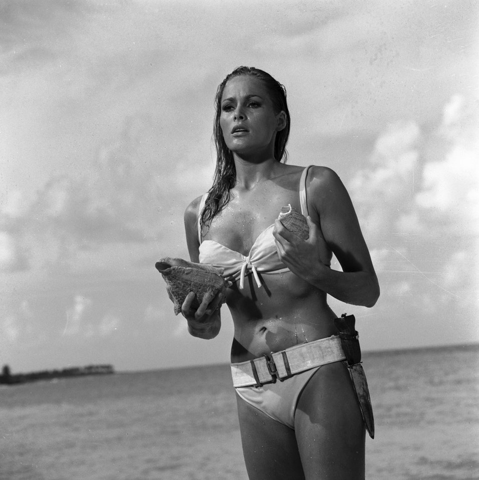 "This undated publicity photo provided by United Artists and Danjaq, LLC shows Ursula Andress in a scene from the James Bond 1962 film, ""Dr. No."" When Ursula Andress emerged from the sea, curves glistening, with a dagger strapped to her bikini in 1962's �Dr. No,� she made the Bond girl an instant icon. The film is included in the MGM and 20th Century Fox Home Entertainment Blu-Ray ""Bond 50"" anniversary set. (AP Photo/United Artists and Danjaq, LLC)"