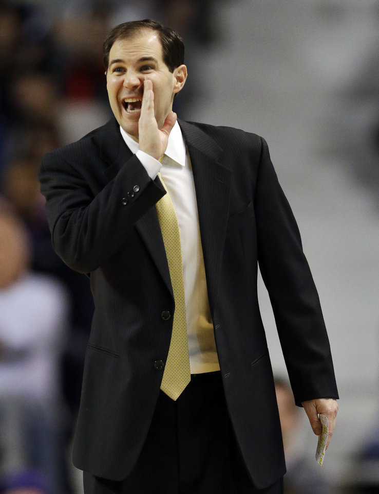 Baylor coach Scott Drew communicates with his team during the first half of an NCAA college basketball game against Kansas State in Manhattan, Kan., Saturday, Feb. 16, 2013. (AP Photo/Orlin Wagner)