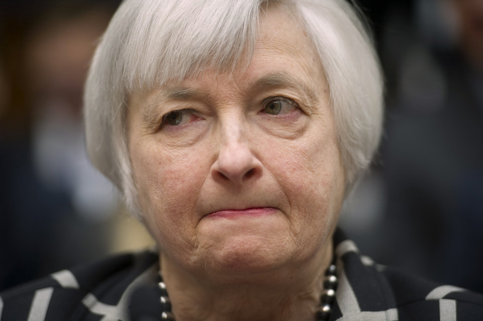 Photo - Federal Reserve Chair Janet Yellen listens while testifying on Capitol Hill in Washington, Tuesday, Feb. 11, 2014,  before the House Financial Services Committee hearing. Yellen said Tuesday that if the economy keeps improving, the Fed will take