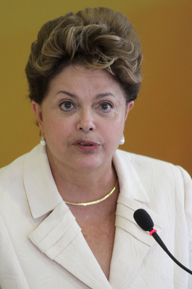 Photo -   Brazil's President Dilma Rousseff speaks during a ceremony where she announced an economic stimulus package at the Planalto presidential palace in Brasilia, Brazil, Wednesday, June 27, 2012. The program announced by Rousseff focuses on a wide array of government purchases, from backhoes to motorcycles to military equipment. Rousseff says the government will use stimulus packages