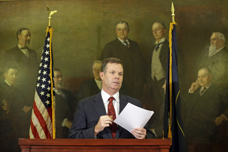 Photo - Utah Attorney General John Swallow speaks during a news conference Thursday, Nov. 21, 2013, in Salt Lake City. Swallow announced Thursday that he is stepping down amid multiple investigations of bribery and misconduct that have hounded him ever since he took office at the beginning of the year.  (AP Photo/Rick Bowmer)