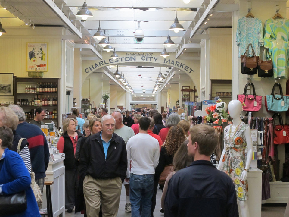 Photo - Visitors crowd the popular City Market in  in Charleston, S.C. on March 11, 2013. The Market has vendors selling everything from T-shirts and jewelry  to paintings and pocketbooks but it's free to wander through and is a great place to people watch. (AP Photo/Bruce Smith)