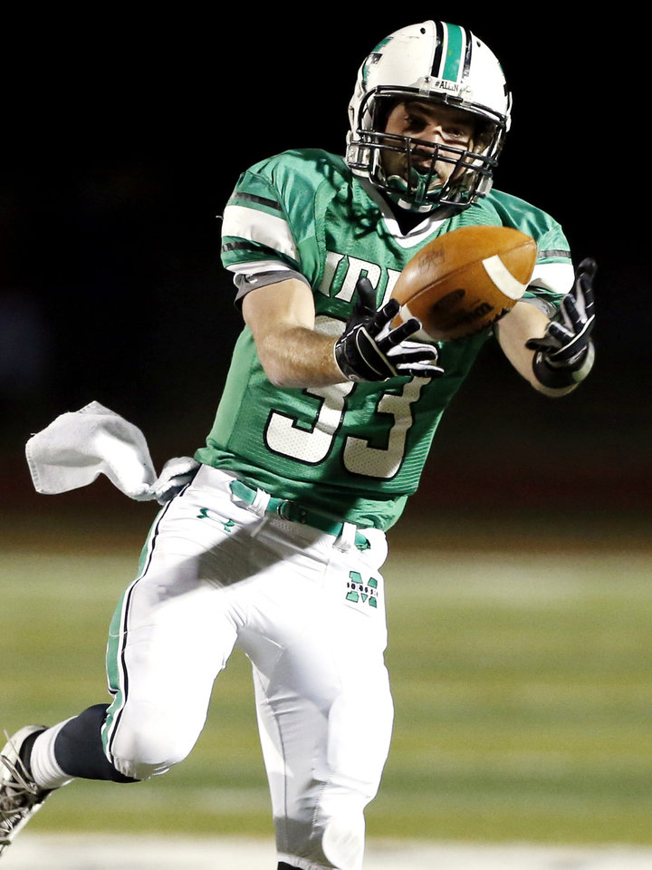 Photo - Irish running back Danny Krenger catches a pass in the first half as the Bishop McGuinness Irish play the Carl Albert Titans in a Class 5A semi-final playoff game at Harve Collins Field on Friday, Nov. 23, 2012  in Norman, Okla. Photo by Steve Sisney, The Oklahoman