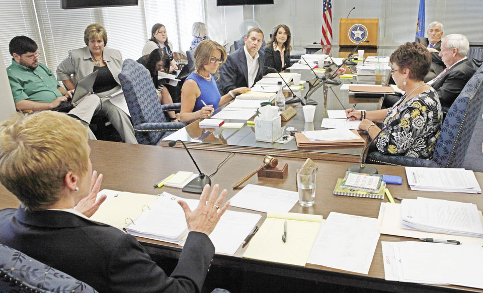 Photo - Janet Barresi, left, Oklahoma State Department of Education State Superintendent of Public Instruction at a Board of Education deciding to grant high school diplomas to several Oklahoma students who failed state-mandated end-of-instuction exams, Tuesday, June 5, 2012.  Photo By David McDaniel/The Oklahoman  David McDaniel - The Oklahoman