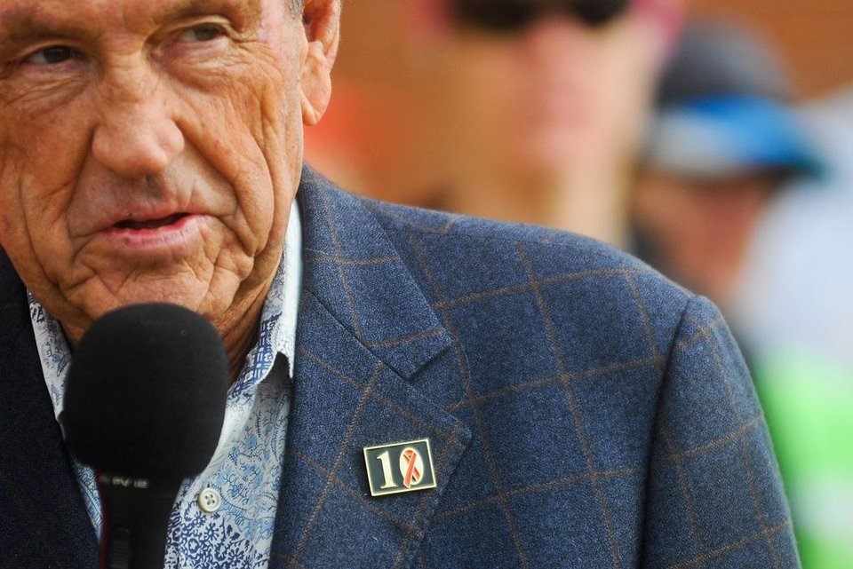 Photo - Former Oklahoma State basketball coach Eddie Sutton wears a pin to commemorate the ten members of the Oklahoma State basketball family killed in a 2001 plane crash. Sutton spoke to runners before the beginning of the Seventh Remember the Ten Run on the campus of Oklahoma State on April 20, 2013. [The Oklahoman Archives]
