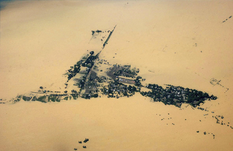 Photo -   This aerial photo shows a flooded area of Jorhat in Assam state, India, Monday, July 2, 2012. The floods from monsoon rains in northeastern India killed dozens of people, with more than 2,000 villages inundated as rivers breached their banks, an official said Sunday. (AP Photo) INDIA OUT